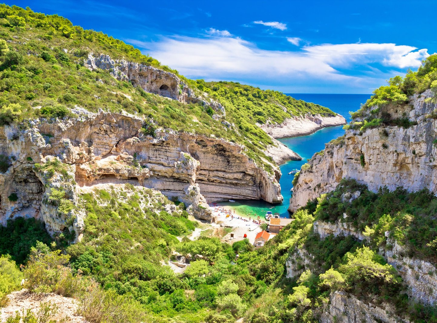 View from the hill of the Stiniva beach on island Vis hidden inside the Stiniva bay