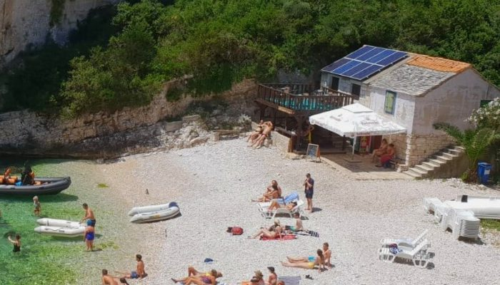 Tavern Peruka, only tavern in Stiniva beach and people sunbathing in front of tavern